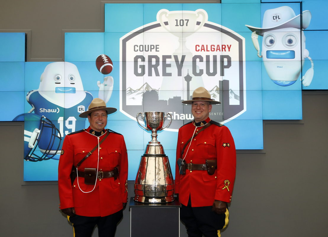 RCMP Officers pose for a picture with the Grey Cup. Photo Credit: Todd Korol