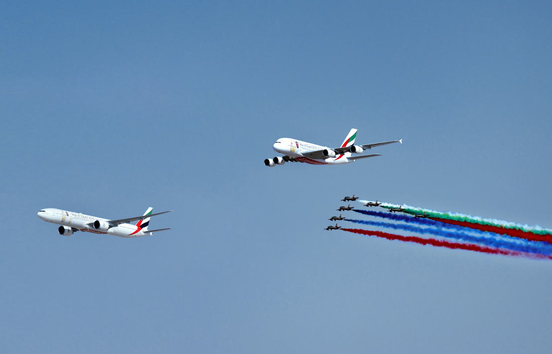Emirates Boeing 777 and Airbus A380 open Dubai Airshow flying display in spectacular fly past with Al Fursan