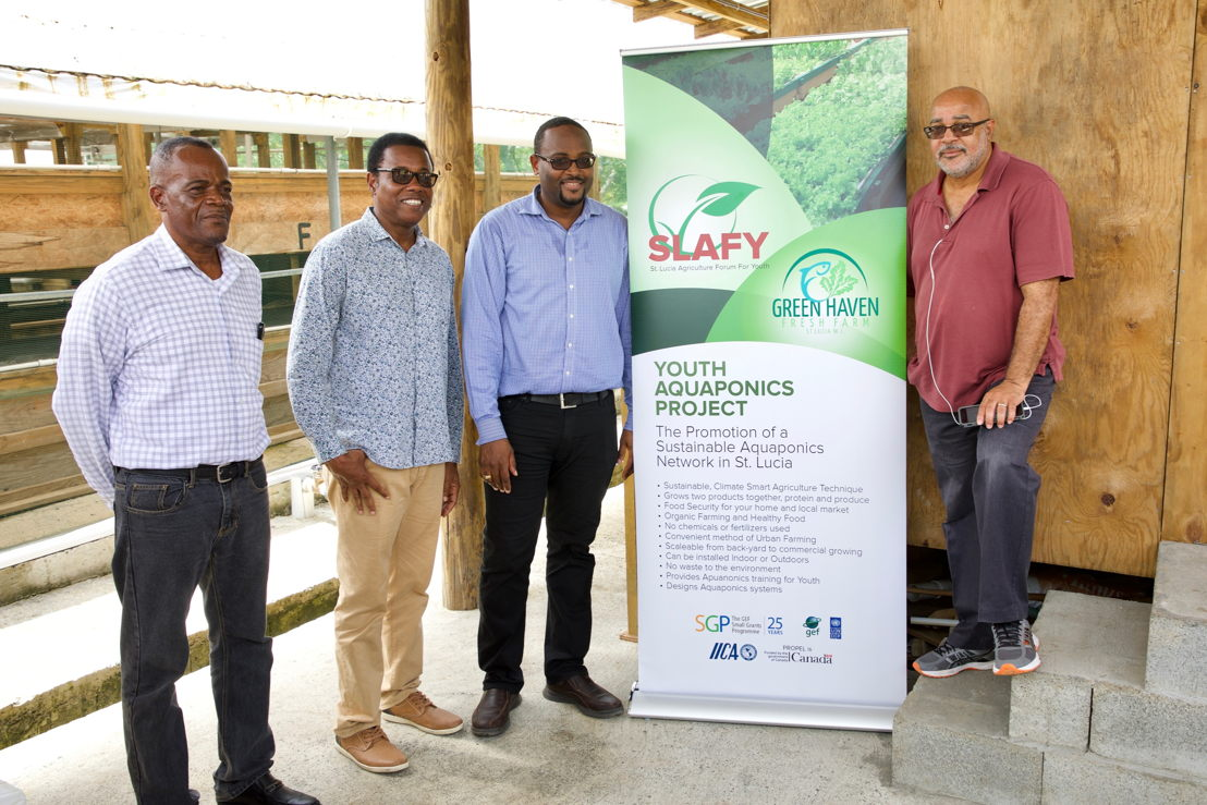 OECS Director General Dr. Didacus Jules (right) with Minister Jonas and delegates supporting aquaponics growth in the OECS