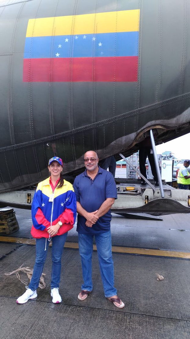 OECS Director General, Dr. Didacus Jules and Venezuela's Ambassador H.E Leiff Escalona stand in the shade of National Bolivarian Armed Forces C-130 as it prepares to leave for Dominica.