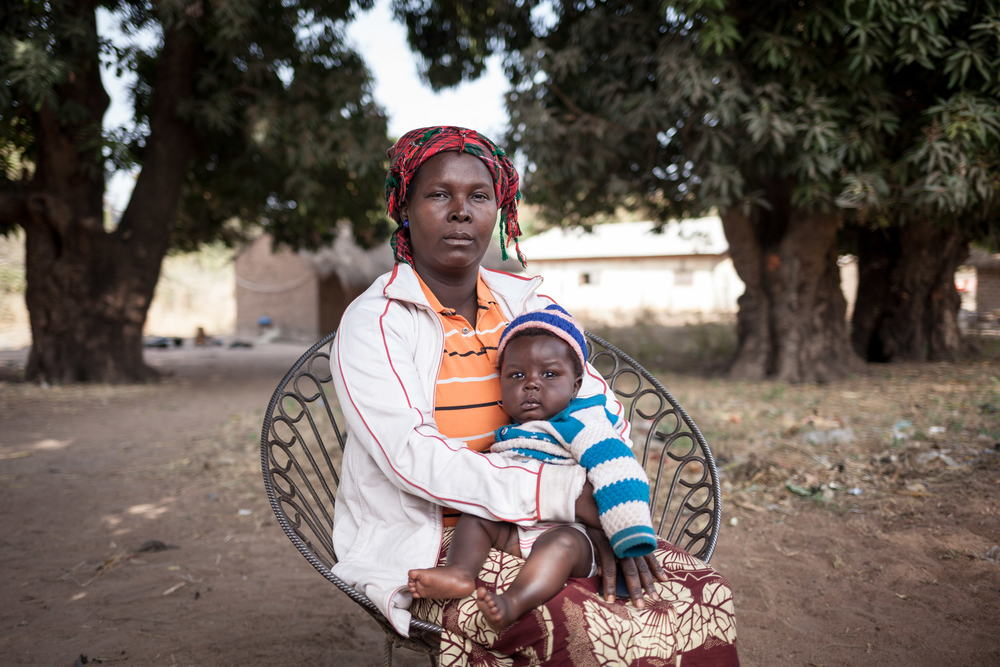 Josiane Wankian, 37, mother of nine children. She fled Betokomia with her children, northwestern Central African Republic, after an armed group attacked their village. Her husband had fled shortly before when he heard rumours of attacks. She hasn't heard from him since. In the fleeing, she lost one of her children. She now lives with her sister in Paoua. Paoua, December 29, 2017. Photographer: Alexis Huguet