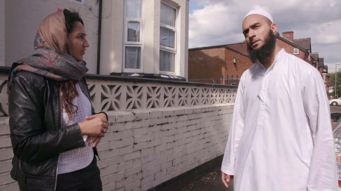 Amina Lone asking imam if there is room for women to pray at the  mosque