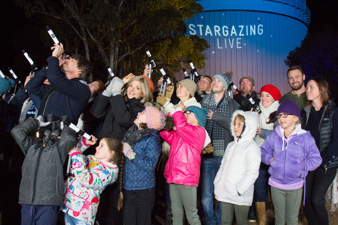 Hosts Professor Brian Cox and Julia Zemiro stargazing with other Guinness World Record participants at Siding Springs Observatory - photo Luke Wong