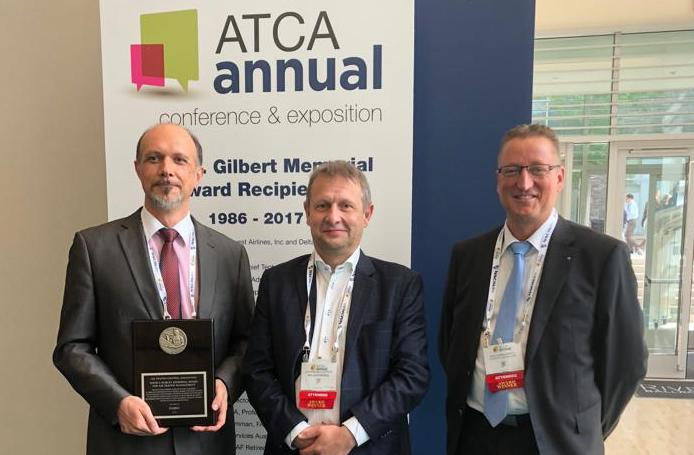 FABEC's Johan Decuyper (in the middle) receives prestigious ATCA award in US