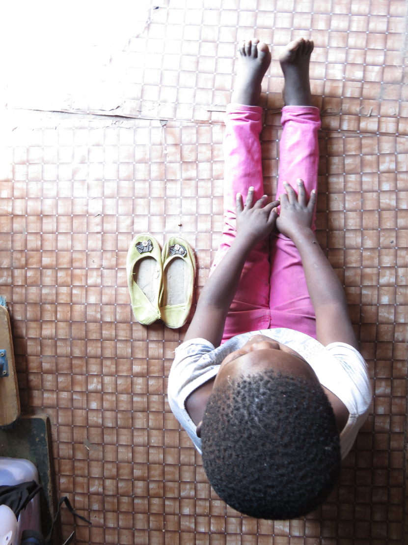 1.A young girl trapped in conditions of poverty, putting her at risk of falling victim to sexual violence, like her older sister. Photographer: Marcus Finiosse