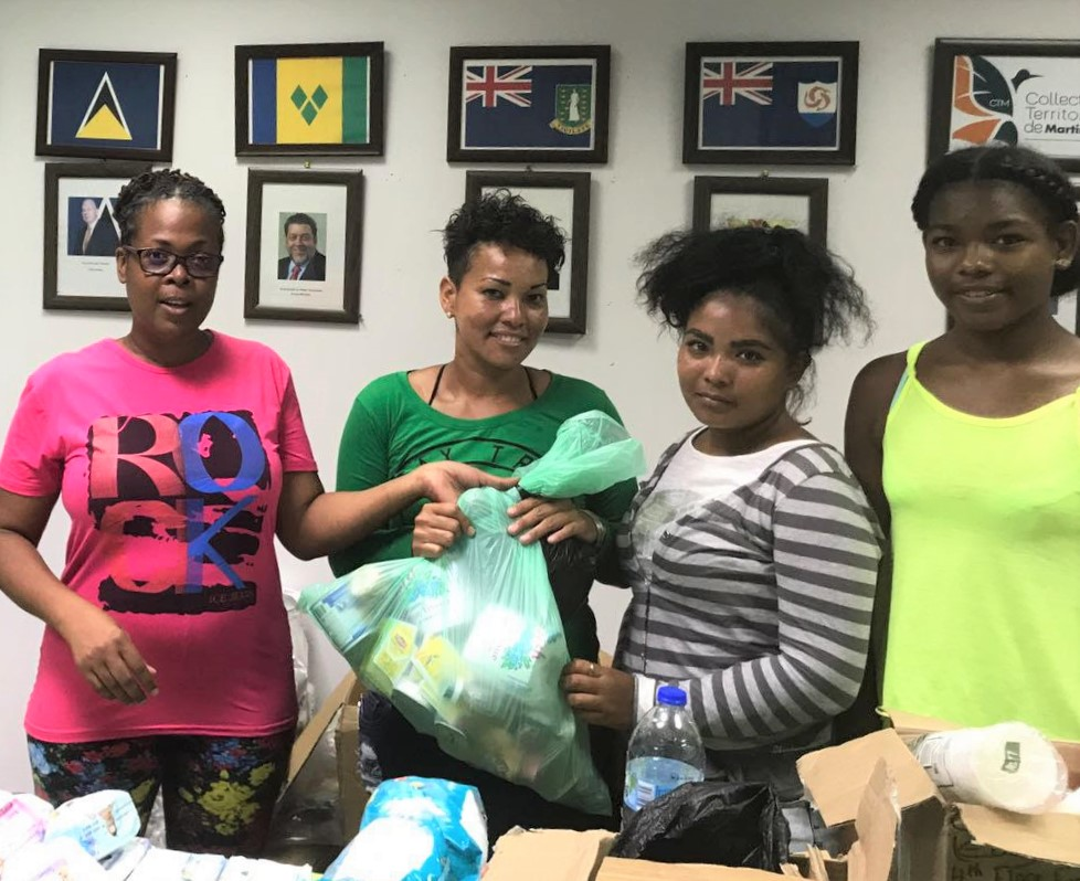 Family receiving aid at the OECS Dominica Office.