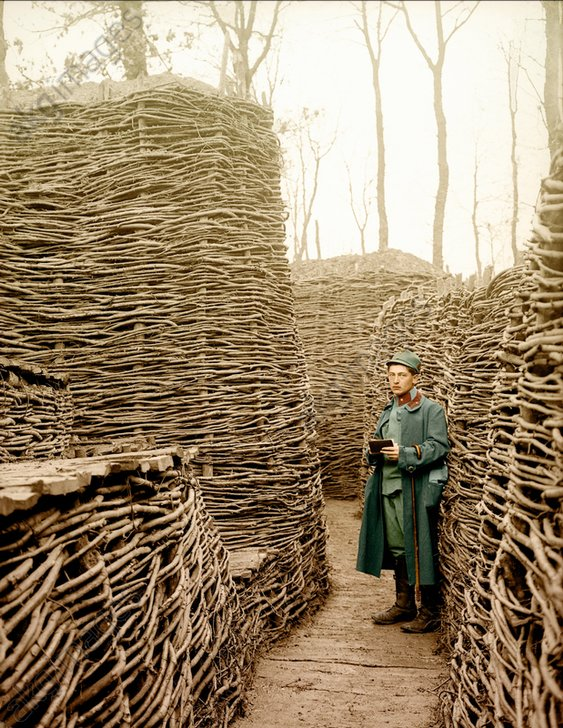 WWI / Austrian soldier in a trench secured by fascines. Colourised photo, Russia, 1915<br/>AKG1656678