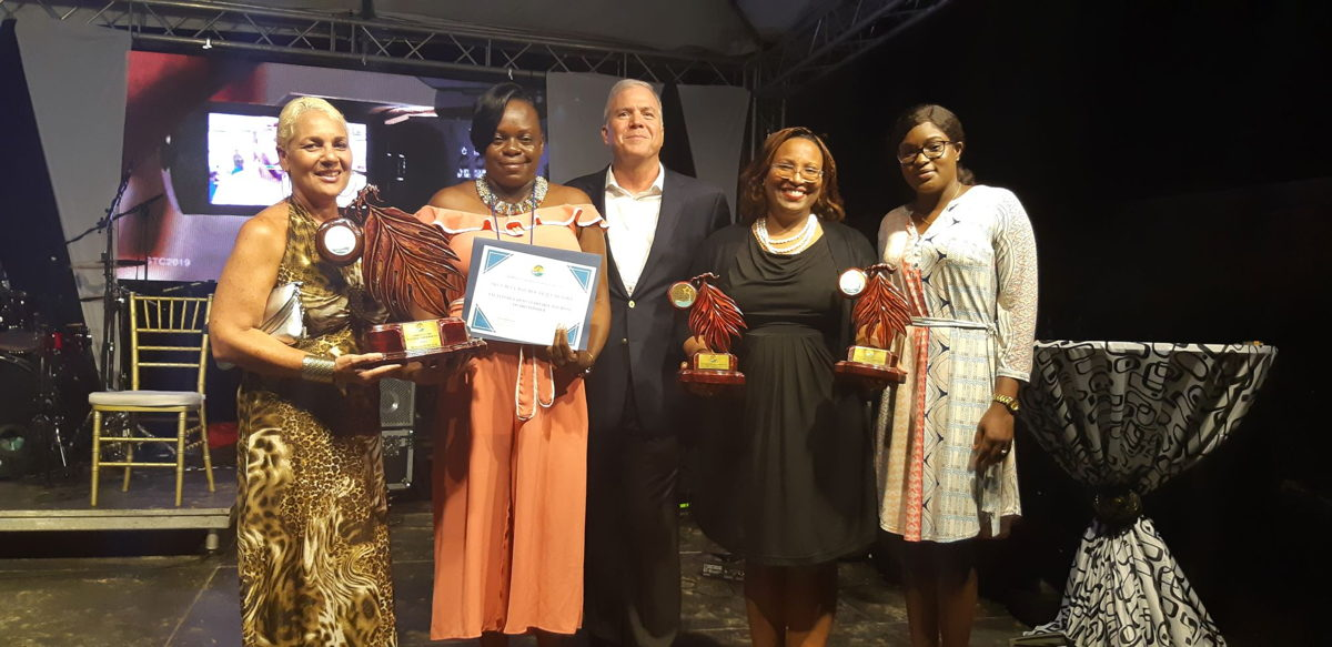 OECS Tourism Specialist, Maria Fowell (left) with Representative from Carnival Corporation & plc and the STC2019 winners from Grenada
