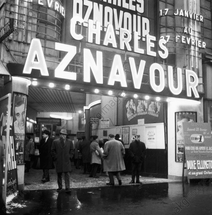 """Entrance to the """"Olympia"""" with an illuminated sign for a concert by Charles Aznavour.<br/>AKG179135"""