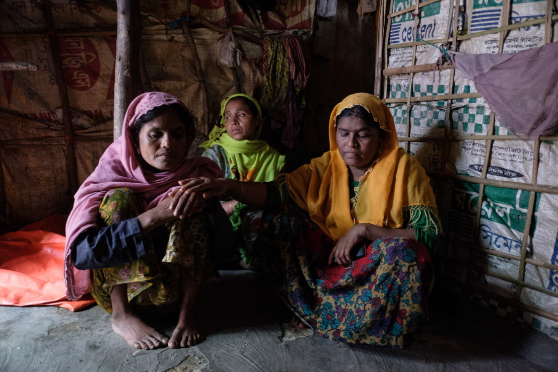 A 40 year old woman (in pink scarf) who has lived in the old section of Kutupalong Makeshift Settlement for the past 10 years, sits with relatives in her home. Photographer: Antonio Faccilongo
