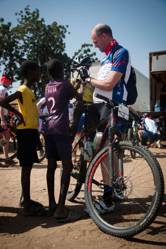 Hans Bourlon lets local kids check out his bike