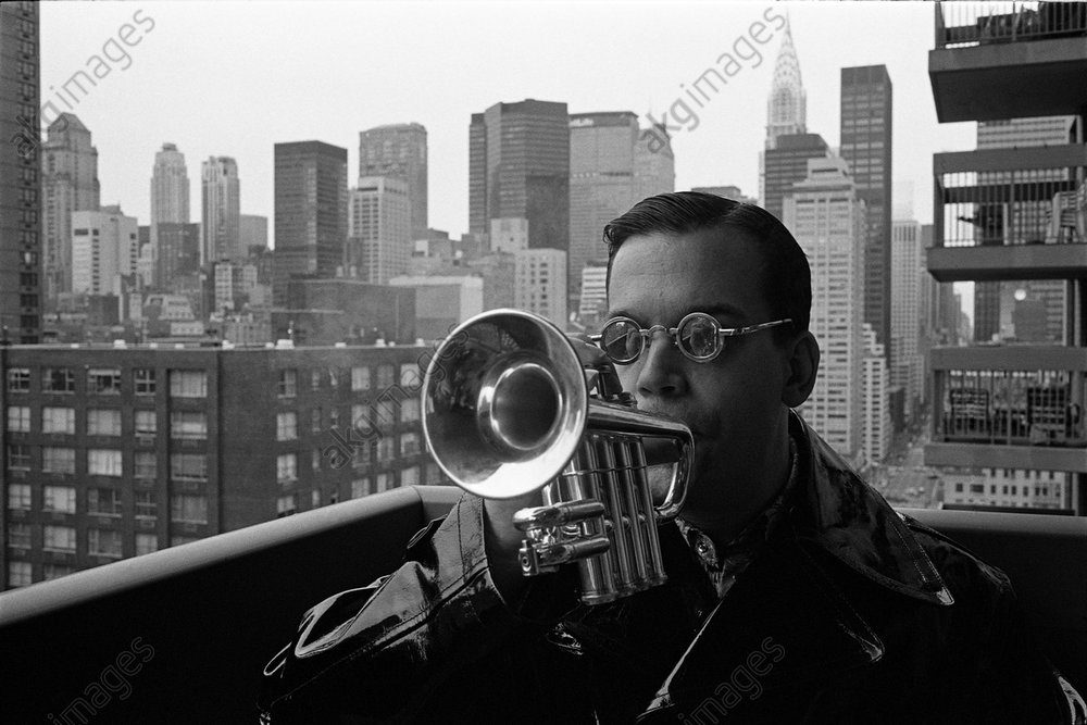 Mac Gollehon Playing the Trumpet on the Balcony of his New York Flat<br/>AKG3543195