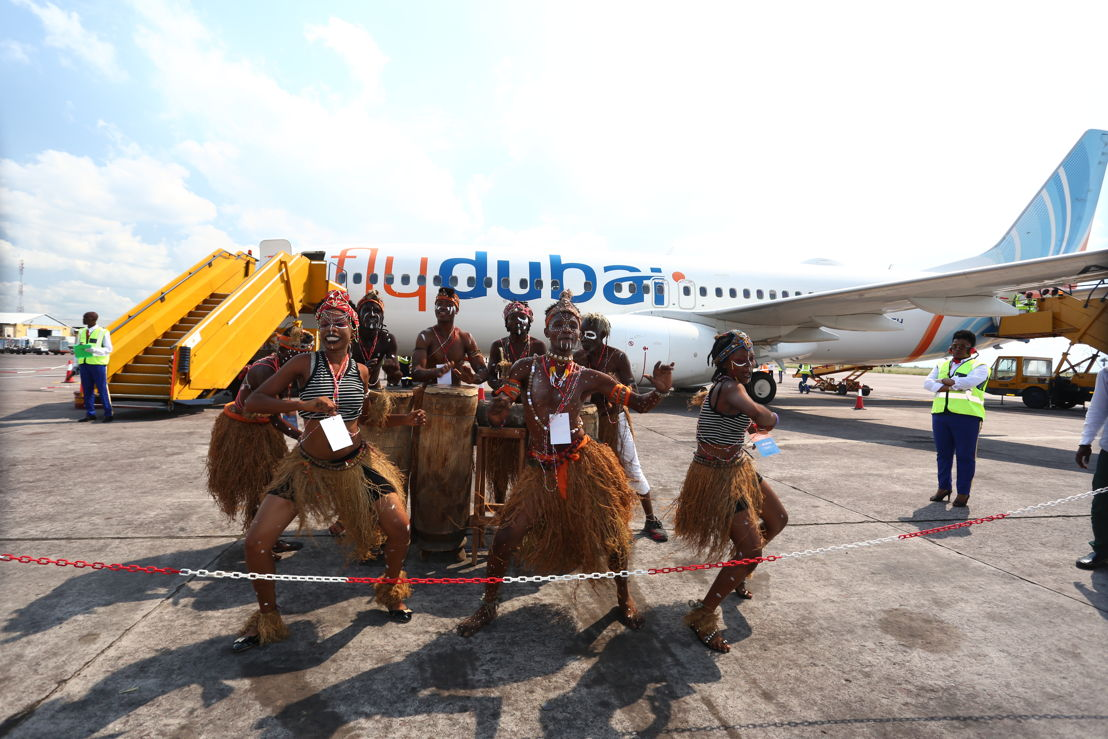 Traditional dancers greet the aircrafts arrival