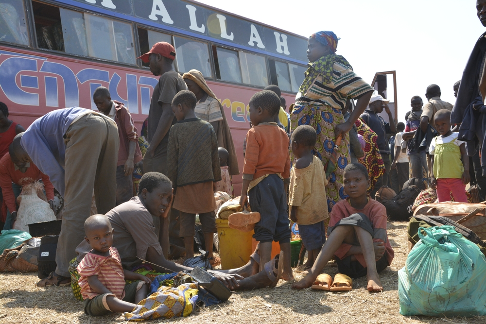 System identifier: MSF149778<br/>Title: Nyarugusu camp - Tanzania<br/>Photographer / cameraman: Louise Annaud<br/>Countries: Tanzania<br/>Description: Arrival of a bus with new Burundian refugees coming from Kigoma. Some people have been on the road for a week and had to walk for miles.