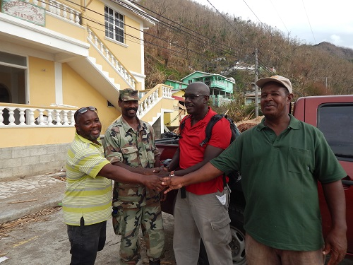 Solidarity in the face of hardship: Ambassador to the OECS H.E Dr. Patrick Antoine (centre) with residents and first responders in Dominica