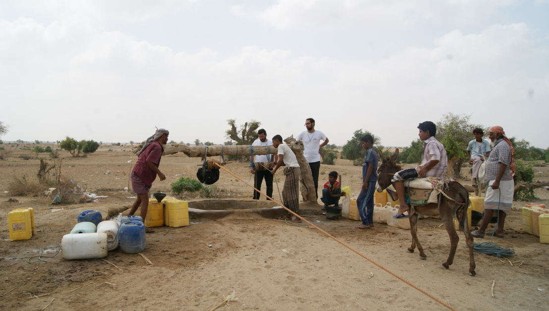 People fetching water in Abs, Hajjah governorate, reflecting the direct and indirect effects of the war in Yemen: near the frontlines, the region is home to constant armed clashes and violations of international humanitarian law; it hosts a large number of uprooted people; medical care and other basic social services are widely unavailable; and humanitarian assistance for the most vulnerable remains insufficient. Not surprisingly, the cholera and acute watery diarrhoea epidemic is taking a heavy toll on these rural areas, with thousands of people sick and dozens of deaths. Photographer: Gonzalo Martinez. Date photo taken: 05 March, 2017
