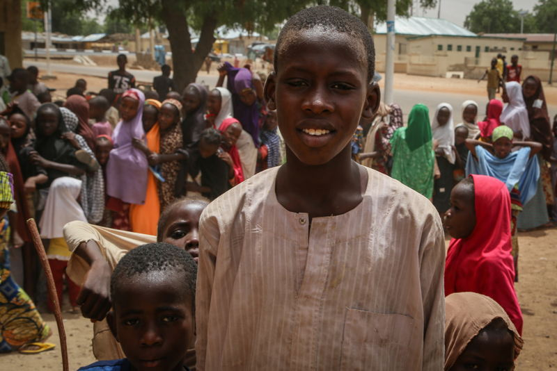 """Mustafa Ibrahim, student from Damaturu (northern Nigeria), 15 years old.<br/>""""There are ten of us in my family and we earn our living by selling goods in the market. I have come here with some of my brothers and sisters. Our father has encouraged us to get vaccinated against meningitis as this disease can create lots of problems. We don't have to be afraid if we get protected."""" Photographer: Igor Barbero/MSF"""