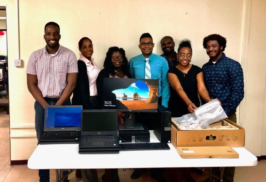 Staff of the CSO Grenada receive desktop and laptop computers.
