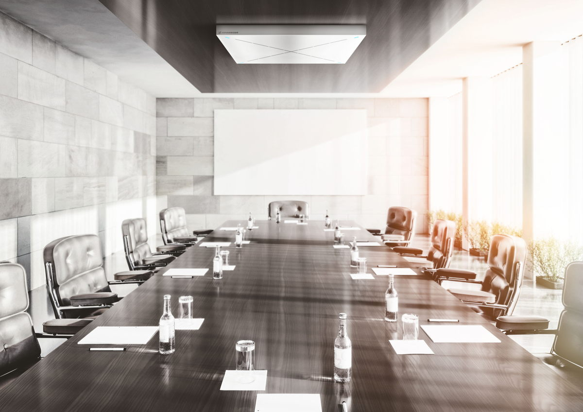 A minimalistically designed meeting room with natural light promotes the concentration of all meeting participants.