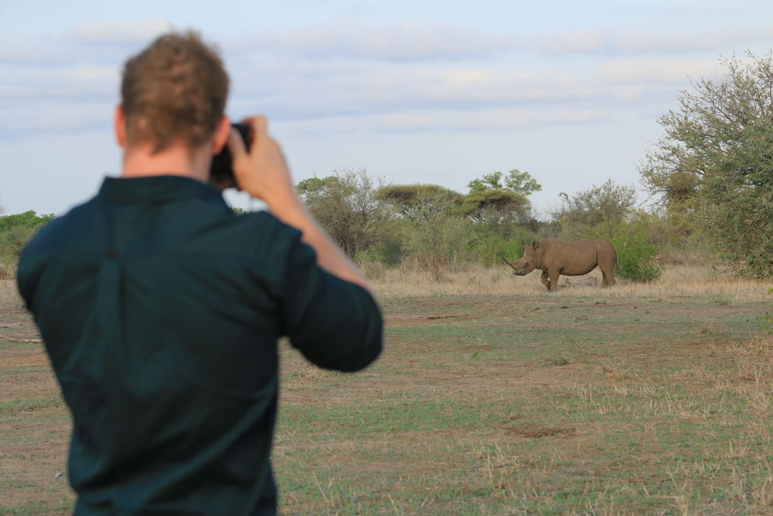 David Pocock taking pic of rhino in Zimbabwe. Photo Winsome Denyer.