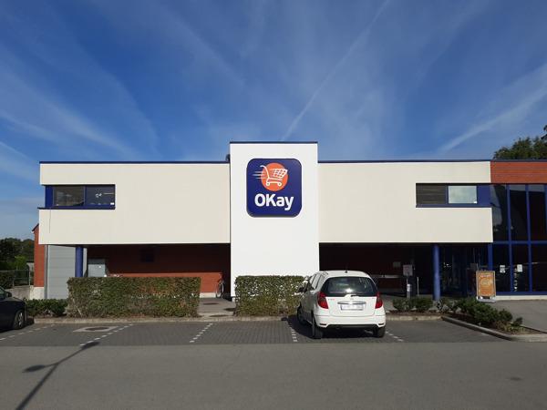 Preview: Eerste grootschalig Belgisch project met luchtzuiverende gevelverf bij winkelketen OKay