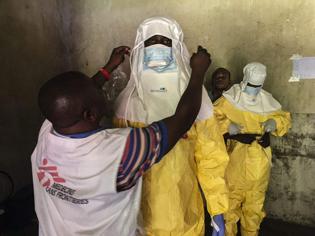 Staff getting dressed in full PPE in the ETC (Ebola Treatment Centre) in Bikoro. Taken 17 May 2018, released 29 May 2018. Credit Hugues Robert/MSF