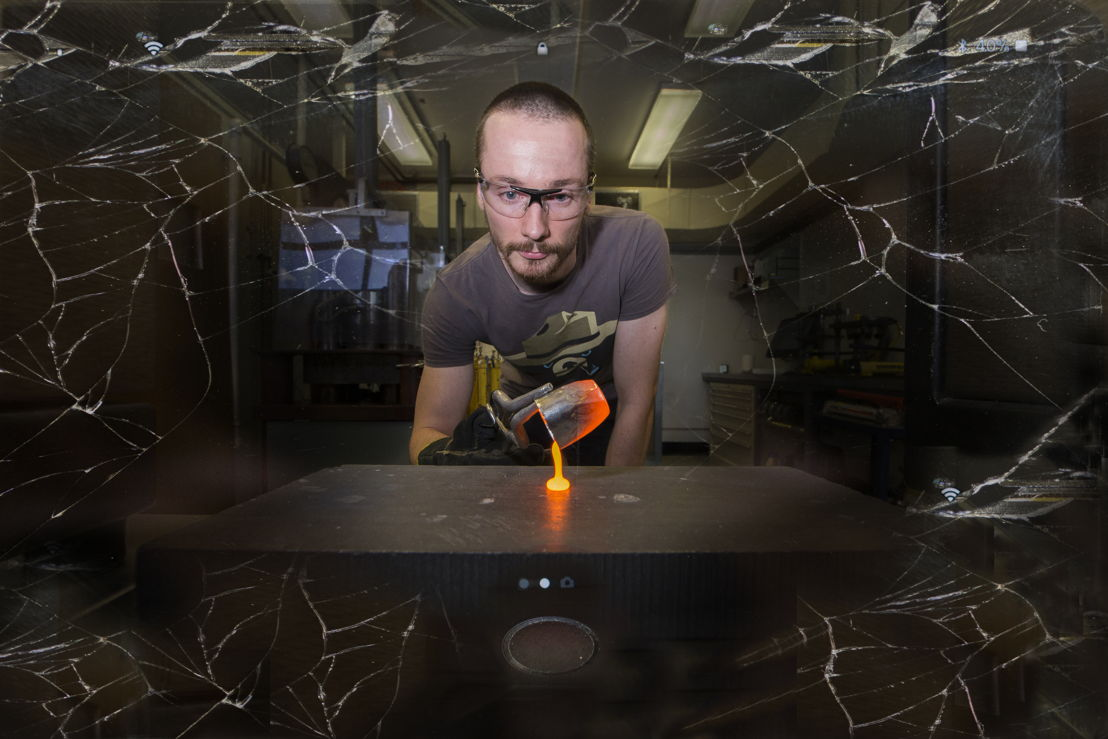 The silicate melt is poured on a graphite plate to make glass (Composite image with smashed mobile phone screen as an overlay). Image credit: Stuart Hay, ANU