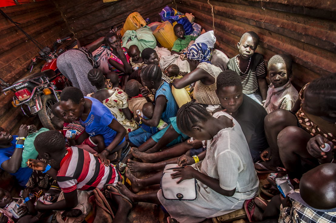 On various points of entry along the border of South Sudan. The refugees are welcomed, fed and as quickly as possible drive by bus to the reception center of Imvepi, located two-hour drive away from there. Photographer: Frederic Noy