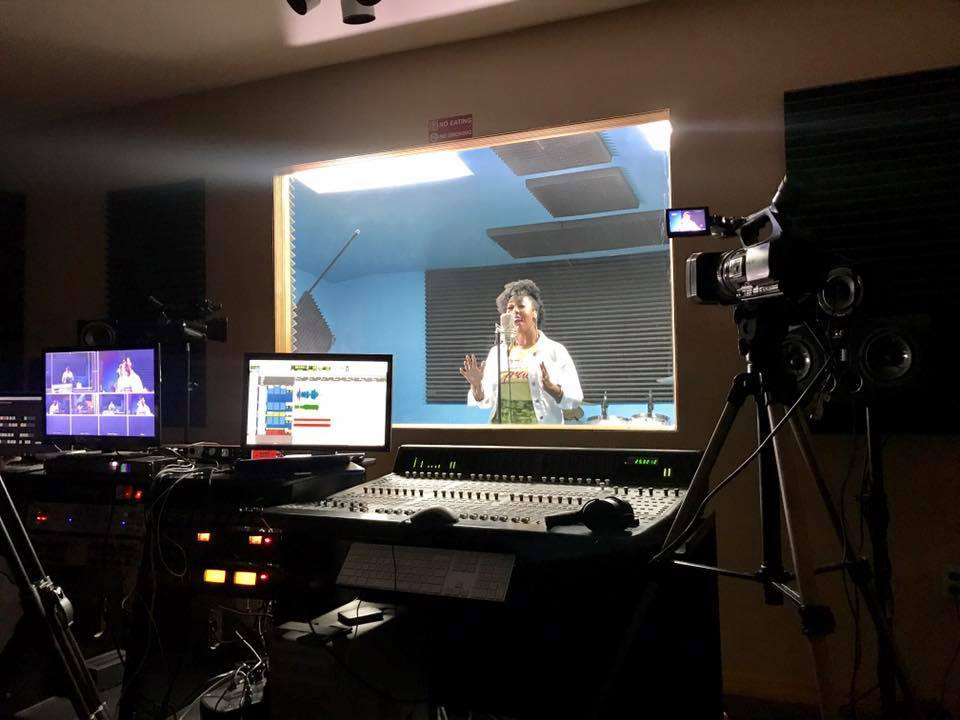 An artiste records a song at Home Grown Studio