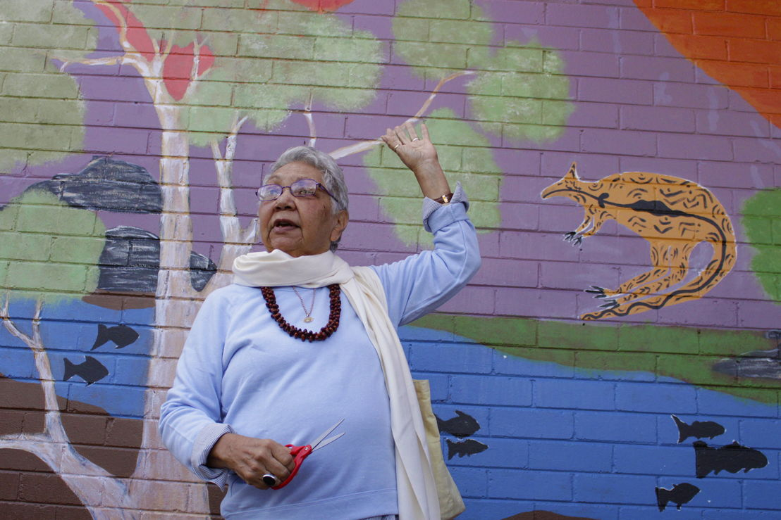 Dr Matilda House in front of one of the murals in Canberra. Image: Adam Spence: ANU.