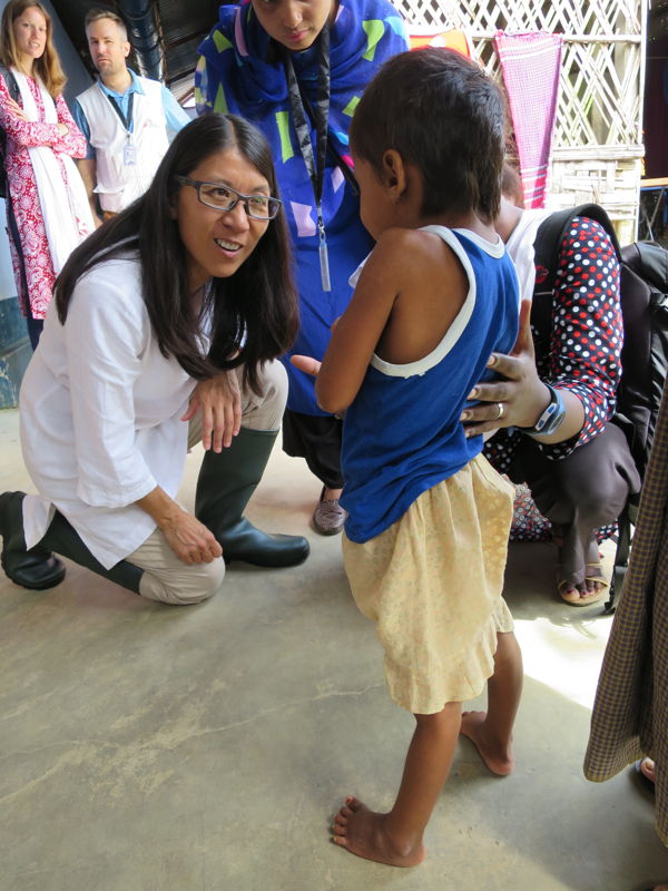 "MSF's President Dr Joanne Liu meets a ten year old girl at Kutupalong Health Facility. The child has just started making a miraculous recovery from tetanus. Doctors had not expected the young Rohingya girl to survive. &#039;Tetanus is a disease that has been eliminated throughout most parts of the world by vaccination.&#039; But not in North Western Myanmar, the home of this girl&#039;s family, where they recently fled from.<br/><br/>MSF's President Joanne Liu reflected about why she was drawn to the little girl as her father proudly helped her walk around the facility: ""Tetanus can have such a high case fatality rate that seeing someone who survived and was walking, it's always, I would say a victory, so this is why I thought it was quite amazing to see her walking around in the clinic."" <br/><br/>[Left to right: Dr Joanne Liu, MSF's Nurse Supervisor Lucky Shamsun Naher Begun and Nurse Activities Manager Jacqueline Murekezi meet with a ten year old tetanus survivor]. Photographer: Amelia Freelander"
