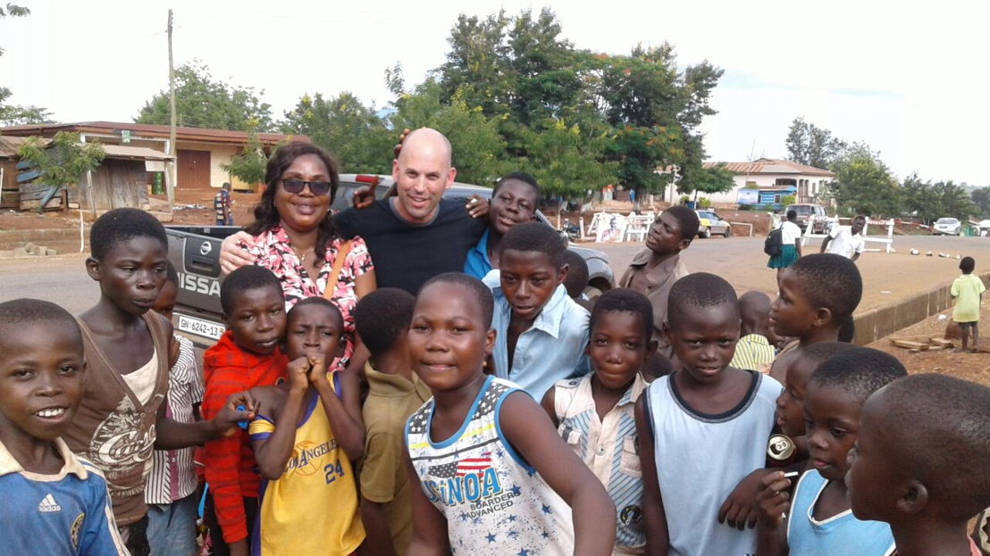Esther Arthur, CLT Ghana operations manager, is surrounded by children in Suma village in Jaman District in Spring 2016. CLT supports health, education and clean water initiatives in Ghana.