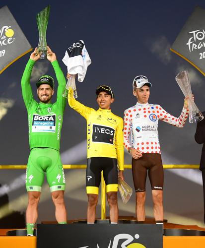 Tour de France winner Egan Bernal celebrates with crystal trophy from ŠKODA AUTO