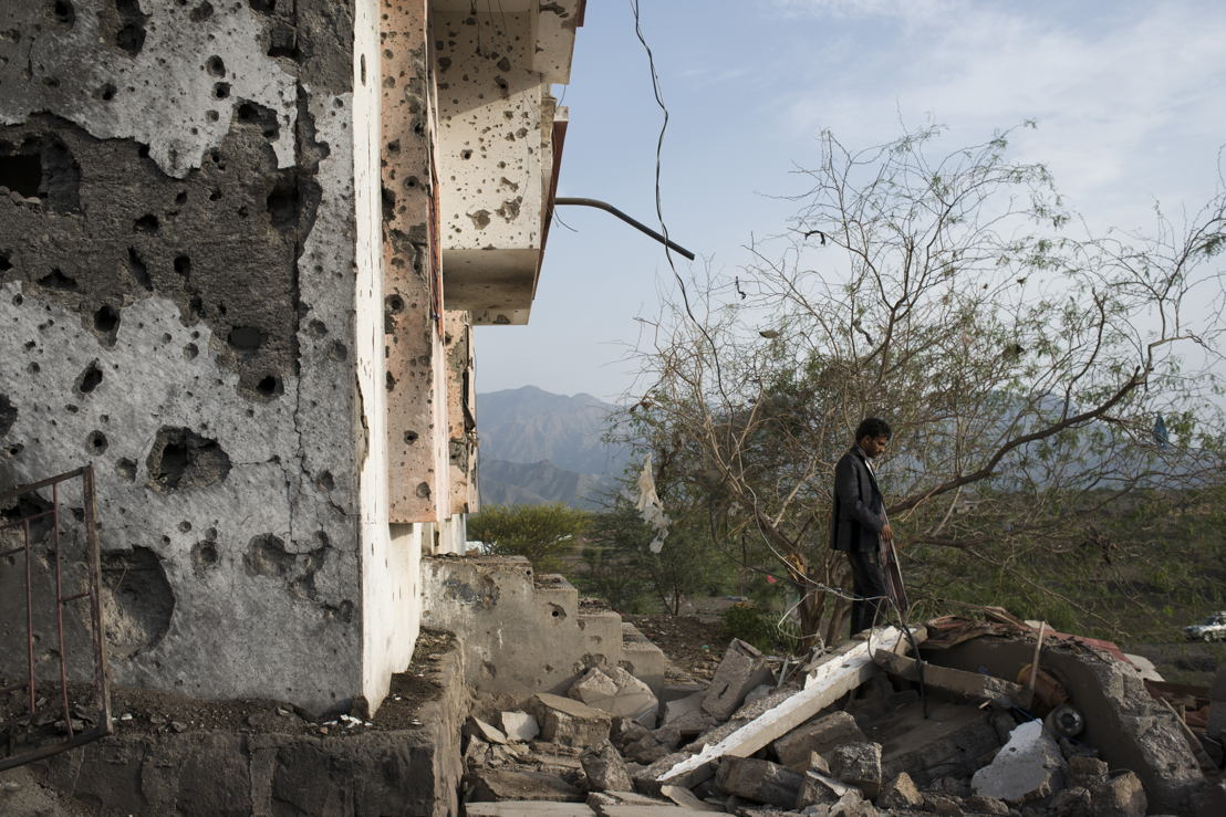 A Yemeni man surveys the damage from an airstrike from the previous night on July 21, 2015 in Qataba, Yemen. At least four missiles struck a cluster of houses outside Qataba, killing at least four people and injuring dozens, many of whom were brought to the MSF supported hospital in Qataba. Photographer: MSF