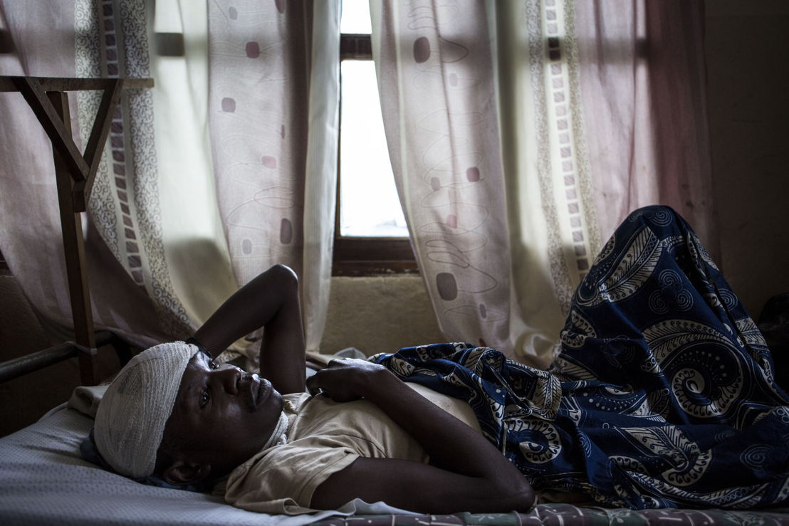 Myime Richards (32), recovers in a hospital room on 2 March 2018 in Bunia. He lost his wife, three of his four children and suffered servere lacerations to his head and neck after an attack on his village. Fighting in Ituri province has left thousands of Congolese displaced and some 100 have lost their lives. PHOTO/JOHN WESSELS