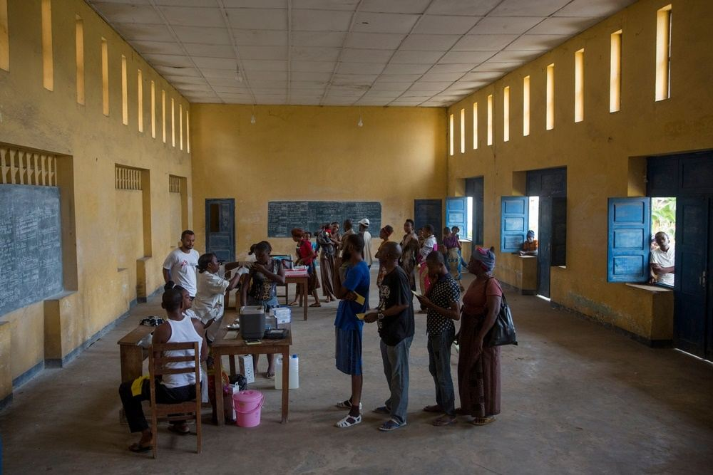 People queue to be vaccinated against yellow fever by A Medecins Sans Frontieres (MSF) in a school in Matadi, Democratic Republic of Congo. Photographer: MSF