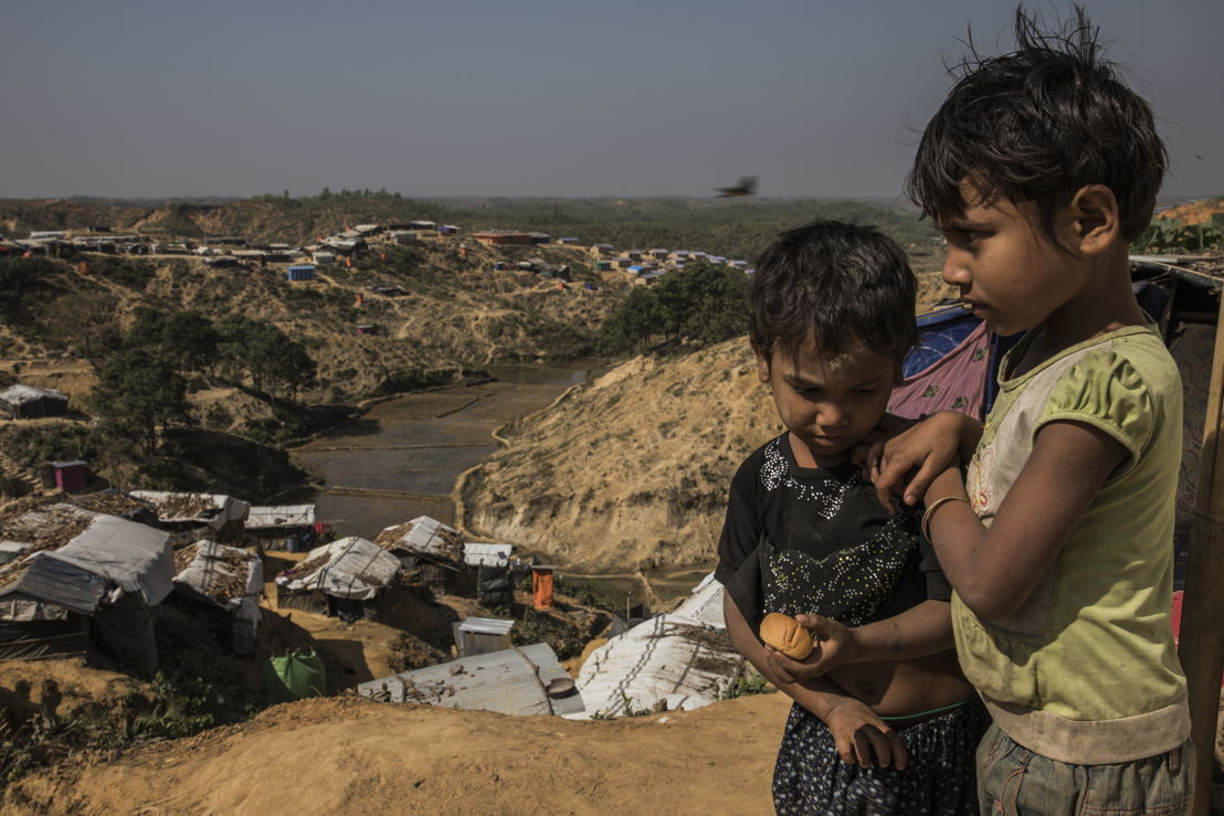 Two Rohingya children in Hakimpara makeshift settlement, where more than 32,000 people are sheltering. Photographer: Anna Surinyach
