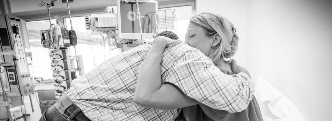 Laine and Jodi Keough embrace