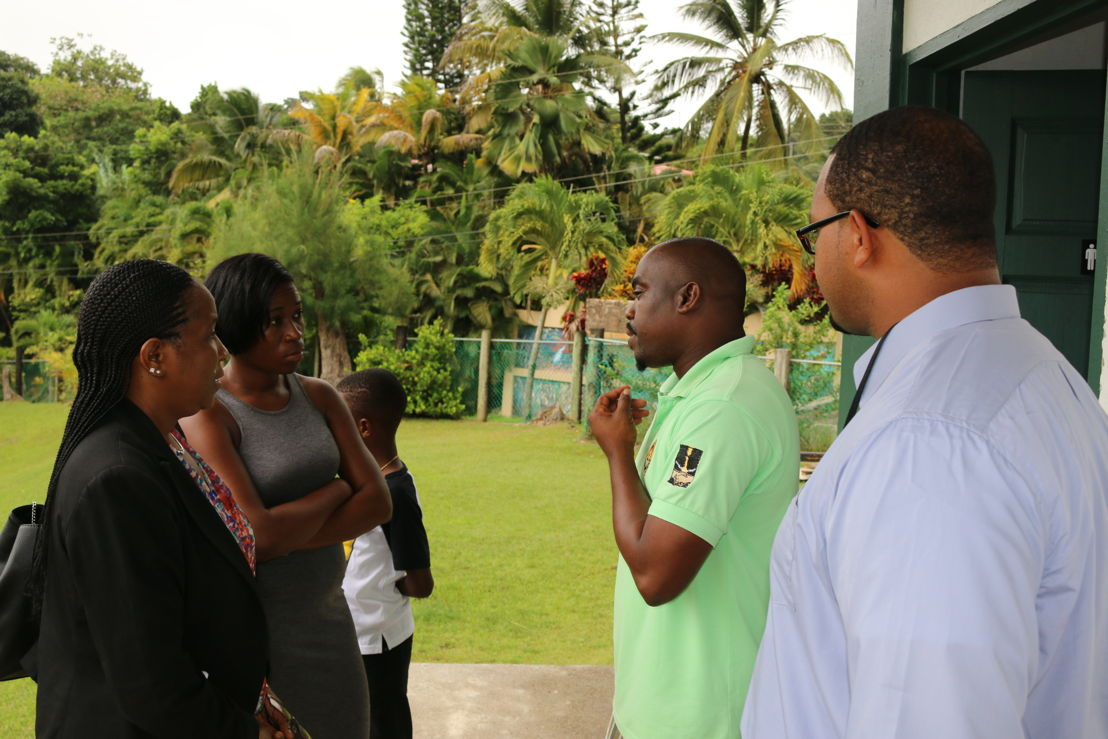 Organisers, Mrs. Josette Edward-Charlemagne and Ms. Sally-Ann Alfred, joined by CCRIF SPC Intern Mr. Daniel Campbell, speak with Principal Mr. Ezra Joseph.