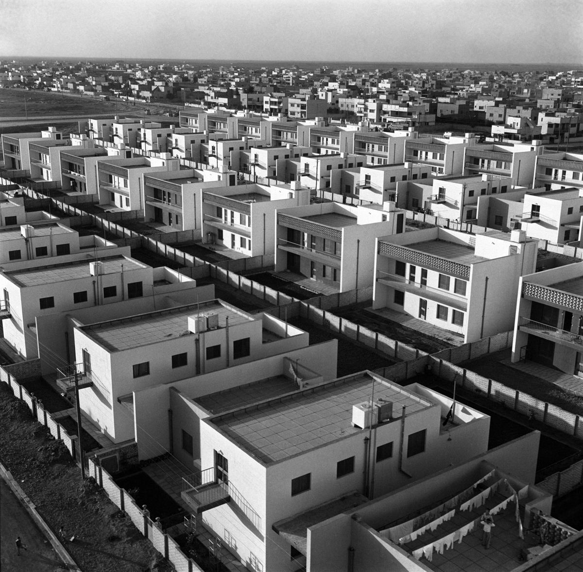 Latif Al Ani, Housing project office, Yarmouk, Baghdad, 1962, (2019) Inkjet print on Hahnemuhle fine art photo rag pearl paper 100 x 100 cm Edition of 3 + 2 AP (LAA/PH 016). Latif Al Ani Collection, courtesy of the Arab Image Foundation, Beirut and Gallery Isabelle van den Eynde, Dubai.