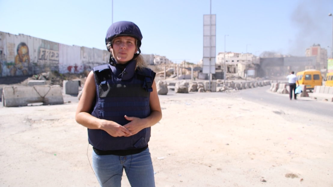 Sophie McNeill does a piece to camera in Israel