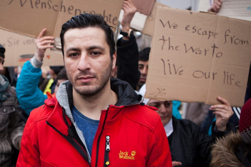 "Iwath, from Iraq, protests against border controls outside a reception centre for migrants and refugees near Sid, Serbia. ""We want freedom and a future - we don't have freedom in my country. I want to continue my journey, I can't go back."" Photographer: Alex Yallop/MSF"