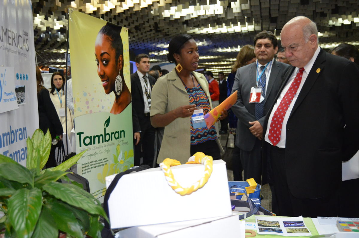 Tamara Prosper, owner of Tambran by Tamara presents her products to judges at an international expo.
