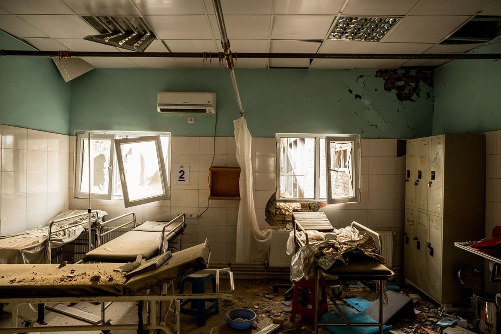 System identifier<br/>: MSF154393<br/>Title<br/>: Kunduz Hospital After the Attack<br/>Photographer / cameraman<br/>: Andrew Quilty<br/>Countries:<br/>Afghanistan<br/>Description<br/>: Burnt-out corridors, collapsed roofs, twisted metal and ash, is all that remains of many<br/>building at the MSF Trauma Centre in Kunduz, northern Afghanistan, following the 03 October US<br/>airstrike on the facility which killed more than 20 MSF staff members and patients