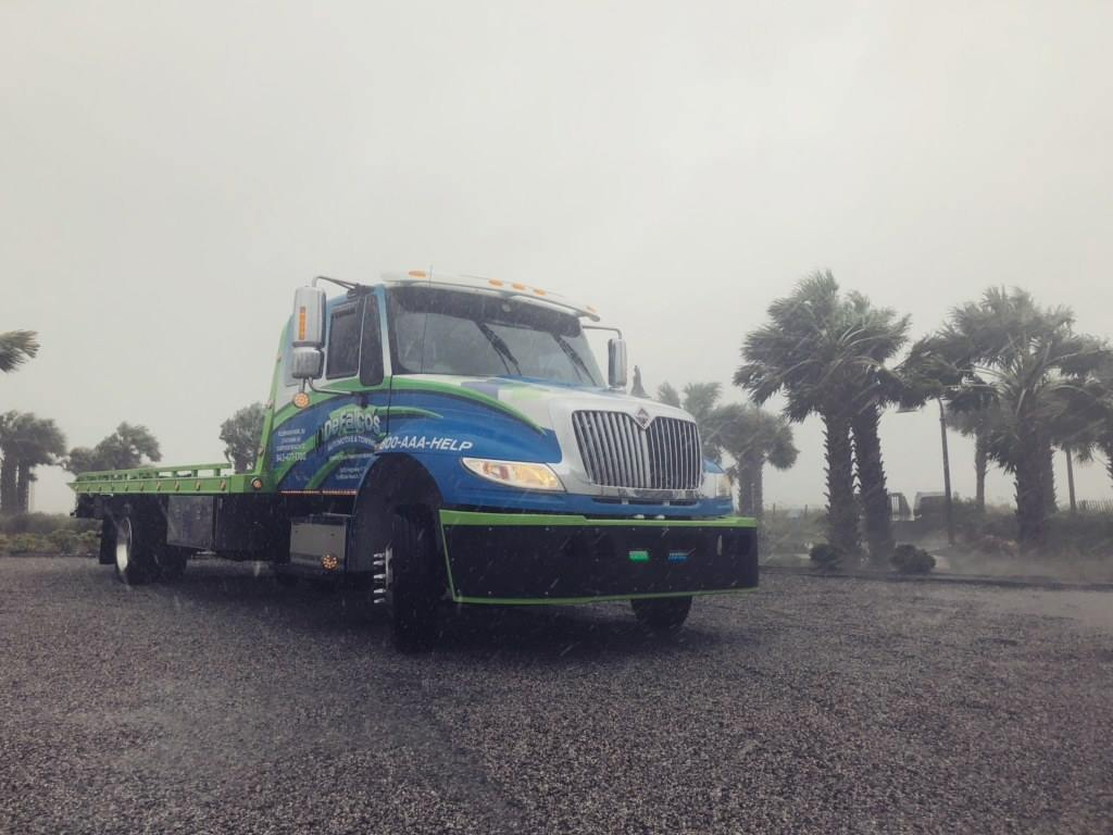 One of DeFalco's tow trucks, driven by Evan Davis, gets lashed by wind and rain during Hurricane Florence.