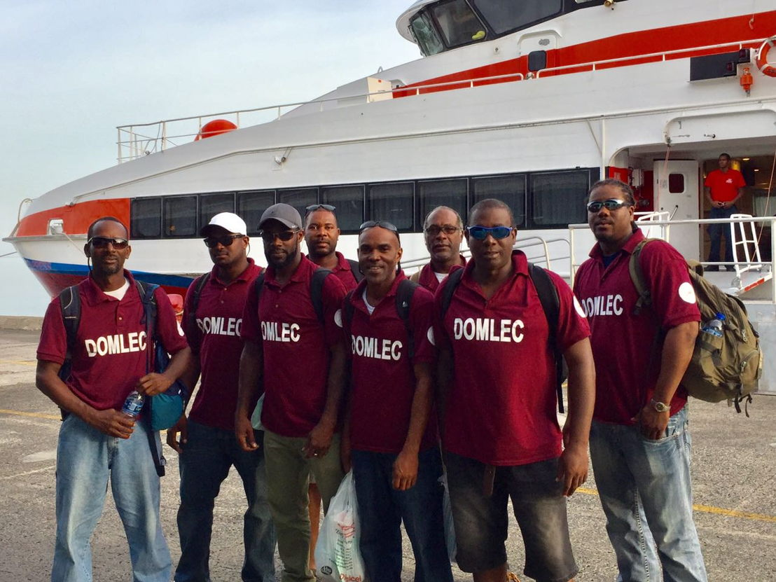 A team from Dominican Electricity Services arrive back home after helping in Anguilla