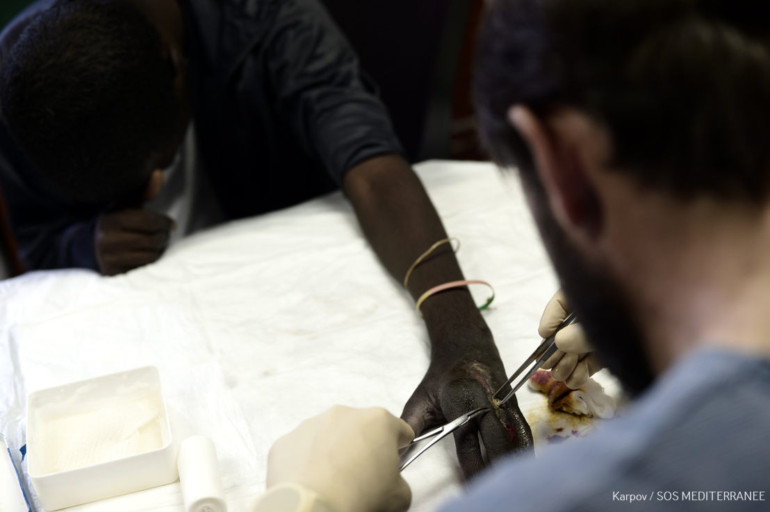 MSF medics are treating a man whose finger was partially amputated in Libya.<br/><br/>Many refugee and migrants have endured alarming levels of violence and exploitation in Libya and during harrowing journeys from their home countries. Photographer: Kenny Karpov