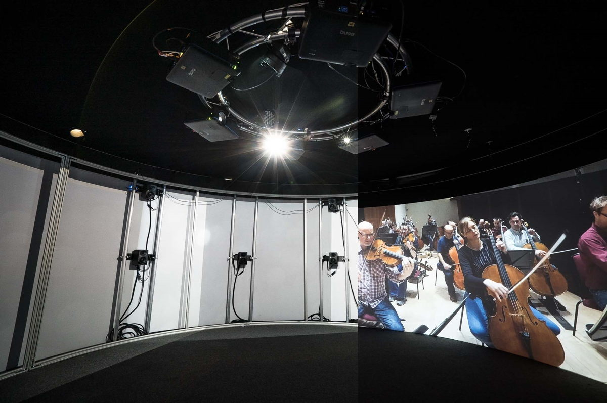The Neumann KH 80 DSP loudspeakers are set up in a 9.1 arrangement behind the acoustically transparent screen of the Igloo cylinder, fully enveloping visitors in the orchestra sound