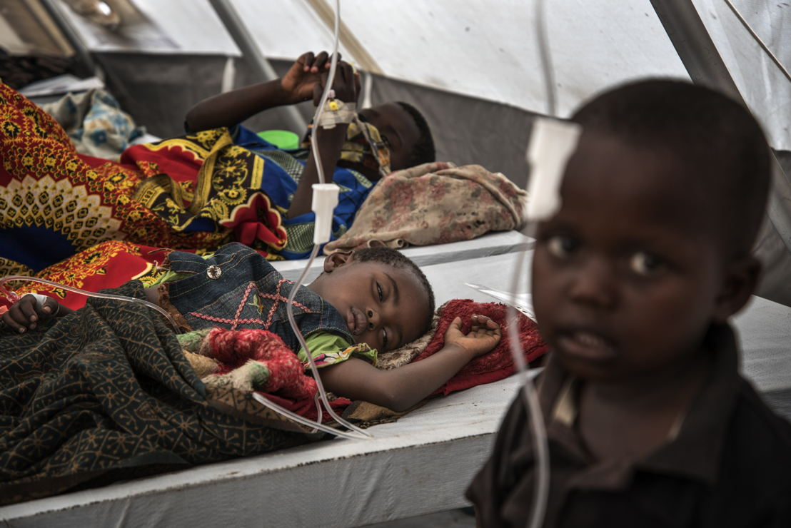At the cholera treatment centre in Minova, rows of beds are filled with children, lying or sitting listlessly as their mothers weave in and out of the tent, some wringing mops, others trying to encourage their children to drink. Photographer: Arjun Claire
