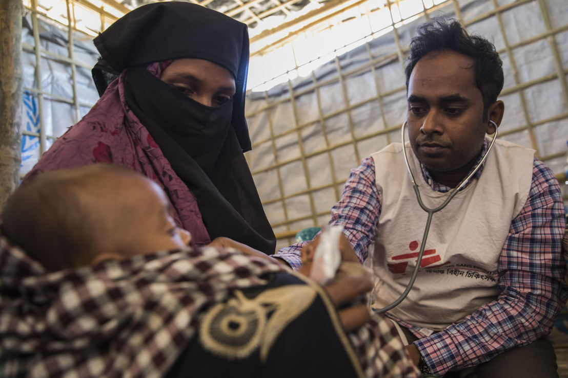A young boy is examined by a doctor in MSF's clinic next to Nayapara refugee camp. The child's mother, Mumtaz, arrived in Bangladesh in October 2017 to escape the latest wave of violence in Rakhine State, Myanmar. His father died trying to reach Bangladesh. Photographer: Anna Surinyach